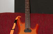 Ernie Ball Music Man JP7 – Tangerine Pearl